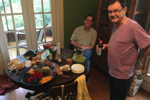 Lowdown publisher Jay Harris and Hightower settle in for snacks (and beer)